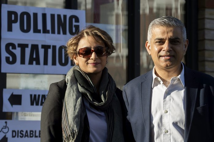 epa05290252 British Labour party candidate for Mayor of London Sadiq Khan (R) poses with his wife Saadiya Khan (L) after voting at a polling station in south London, Britain, 05 May 2016. Londoners head to the polls to elect the successor to London's current Mayor Boris Johnson.  EPA/HANNAH MCKAY